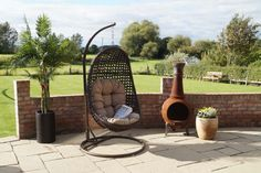 Soak up the sun in style with the beautiful Toulon hanging chair, an essential item to complete any outdoor space. The carefully-crafted cradle hangs gently from a spring-supported post for the most soothing of outdoor seating experiences. Outdoor Living Areas, Living Spaces, Enjoy The Sunshine, Outdoor Seating, Hanging Chair, Garden Furniture, Indoor, Classic, Beautiful