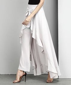 Cascading ruffles bring dynamic movement to these avante-guard palazzo pants. An adjustable waistline helps you find that just-right fit.