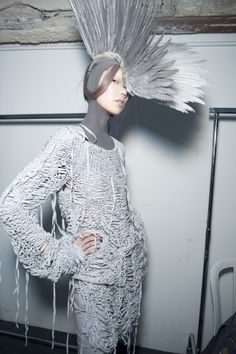 . Gareth Pugh / Spring 2010 / Paris Fashion Week - READY-TO-WEAR (Tao Okamoto ) .   Pugh switched his palette from black-and-white to  hues-of-gray, and the collection saw a new direction for Spring. The feathered headpieces added an Elizabethan slant to his otherwise scuffed apoco-star warrior.  Much like yesteryear's Theyskens for Ricci, Pugh flirted with witchy coats reminiscent of 'Hocus Pocus' .