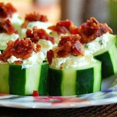 Stuffed Cucumber Bites- except, I would put salmon, low fat cream cheese and drizzle with balsamic vinaigrette! Yum