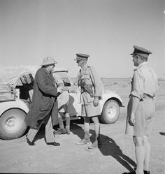 BRITISH ARMY NORTH AFRICA 1942 (E 15295)   Winston Churchill shaking hands with Lieutenant General Ramsden, commanding 30 Corps, while visiting the El Alamein area, 7 August 1942.