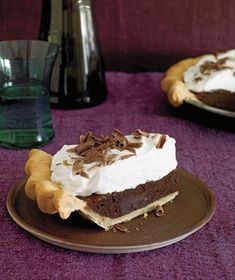 A thick layer of sweet whipped cream hides a dense, rich chocolate filling. Garnish with chocolate shavings for a decadent finish. Get the recipe for Chocolate Fudge Pie recipe.