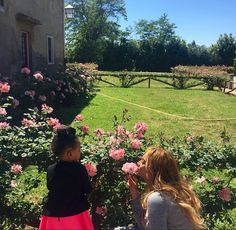 Blue Ivy and Beyoncé literally dmekling the roses in Italy  // Source: Beyonce.com