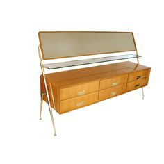 Silvio Cavatorta dresser with glass shelf and mirror.