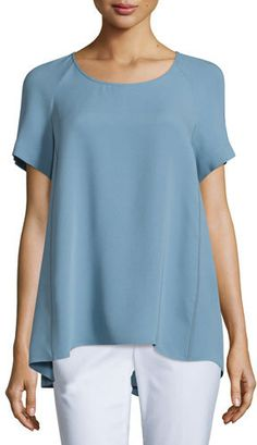 """Lafayette 148 New York """"Katy"""" blouse in double georgette with charmeuse piping. Approx. length: 21""""L from shoulder to hem, 27""""L down center back. Round neckline. Short sleeves; 11""""L. Trapeze silhouette. Slight high-low hem. Silk. Imported of Italian material."""
