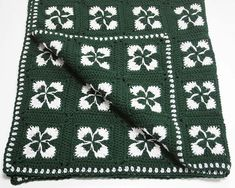 This Crochet Shamrock Afghan will have your Irish eyes smiling before you're through. The easy crochet afghan pattern is great for beginning crocheters who want to get in the holiday spirit. Afghan Crochet Patterns, Crochet Squares, Crochet Motif, Crochet Yarn, Free Crochet, Knitting Patterns, Ravelry Crochet, Crochet Blankets, Granny Squares