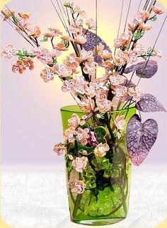 composizione fiori di pesco perline fai da te con vaso biglie vetro foglie decorative fili bambù