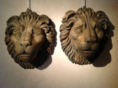 Pair of wooden lion's faces end 18th century 44 cm heigh