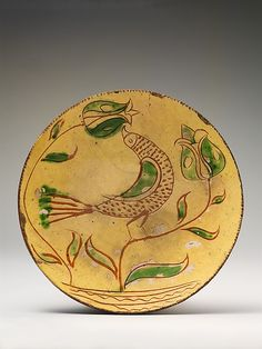 Ceramic Plate with Bird. 1810–55 Mid-Atlantic, Pennsylvania, USA  Earthenware; Redware with sgraffito decoration.