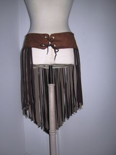 Tribal Flow Fringe Belt by RedLunarMoon.  This one made with Faux leather.  I wonder if I could make one with real leather?