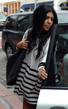 Kourtney Kardashian wearing Bottega Veneta Woven Bag. Kourtney Kardashian At The Shopping District March 22 2010.