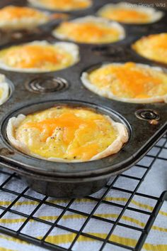 """Ham & Cheese Mini Breakfast Pies 15 ounce box refrigerated pie crust 1 1/2 cups ham, diced 8 eggs 1/4 cup 2% milk 1/2 teaspoon salt 1/4 teaspoon pepper 1 cup sharp cheddar cheese, shredded  Preheat oven to 350 degrees and coat a 12 cup muffin pan with cooking spray. Use a 4"""" round bowl or cup (I use a coffee mug) to measure 12 circles on the pie crust (6 circles on each crust), and cut them out with a sharp knife. Press the circles into the muffin pan, and prick the dough on the bottom of…"""