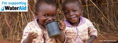 Two children drinking clean water in Zambia