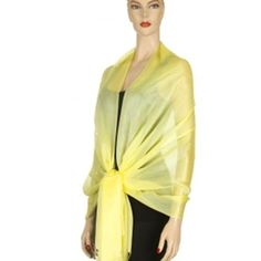 Yellow Long Simple Wide Georgette Shawl Wrap Luxury Divas. $13.99. Imported. The scarf wrap is bordered on both ends with silky thread-like fringe.. Classic and simple, and extremely versatile.. Great when worn as a shawl, or even as a head or hip wrap.. polyester. Makes a great gift.