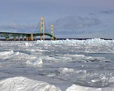 16 x 20 photograph fine art print by Allyson Schwartz, blue ice on Lake Huron Michigan winter 2016 Mighty Mac bridge, Mackinac, Mackinaw. This image is available in 16 x 20 printed on 17 x 22 paper, We do all our own photography work and printing. We use Epson professional archival papers and inks. All printed on Matt finish papers, High resolution. We ship our photos in priority mail triangular tubes with tissue for protection. We print these to order. Any questions just ask.