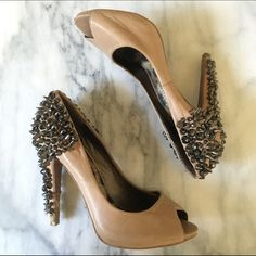 Sam Edelman Spiked Heels Super cute and versatile nude shoes with studded heels. These are well loved but still have a lot of life left in them. Some of the studs have come off the back of the heels and the front by the toes also shows some wear. Sam Edelman Shoes Heels