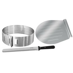 The Frieling Layer Cake Slicing Kit has an ergonomic design that allows you to horizontally slice the cake in up to 8 slices to add frosting in between. This cake slicing kit includes an adjustable slicing mould, 12'' baker's knife and 11'' cake lifter that enables you to cut the cake without it crumbling or coming apart. Made of premium quality material, this cake slicing kit is sturdy and durable. It sports an undecorated look. The Layer Cake Slicing Kit by Frieling is the perfect addition… Stainless Steel Flatware, Stainless Steel Rings, Bakers Kitchen, Kitchen Dining, Patisserie Design, Naked Cakes, Piece Of Cakes, Cake Mold, Pastry Chef