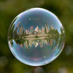 Tom Storm photographs world landmarks in bubbles! Here's the Bean...