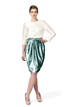 Make an effortlessly glamorous appearance with this PLAKINGER Debut Collection pleated and turquoise sequin pencil skirt. byplakinger.com