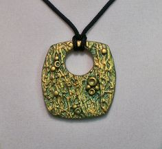 Polymer clay pendant focal bead gold green metallic texture by Sweet2Spicy, via Flickr