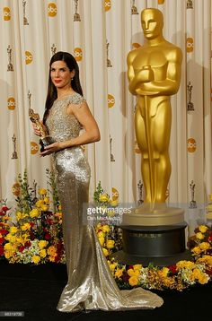 """Actress Sandra Bullock, winner for Best Actress for """"The Blind Side"""" poses in the press room at the Annual Academy Awards held at the Kodak Theater on March 2010 in Hollywood, California. Get premium, high resolution news photos at Getty Images Sandra Bullock Oscar, Woman Movie, Oscar Dresses, Oscar Winners, Celebs, Celebrities, Red Carpet Looks, Best Actress, Gold Dress"""