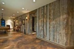 barnwood walls and stained concrete floor. Cool for a basement. by lizzie