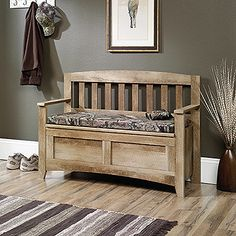 Indoor bench with a rugged outdoors pattern. This bench with storage beneath the seat can conveniently stow away gloves, hats and other outdoor accessories.   Flip-up seat panel reveals hidden storage. Seat pad features Mossy Oak Break-Up Infinity® pattern. Craftsman Oak finish.