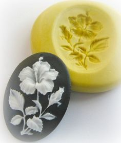 Hey, I found this really awesome Etsy listing at http://www.etsy.com/listing/61061536/flower-cameo-mold-pmc-soap-embed-clay