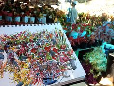 Sketching at the Flower Market, Kona by suhita1, via Flickr