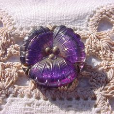 Check out this item in my Etsy shop https://www.etsy.com/listing/224449649/petite-purple-pansy-czech-glass-button