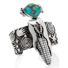 """Handcrafted Turquoise and Sterling Silver """"Corn Maiden"""" Cuff Bracelet made by Navajo silversmith Alex Sanchez."""