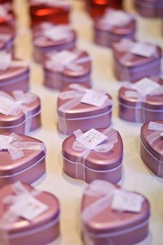 Heart-shaped lilac wedding favors filled  with sweets and candy for guests.--zhb