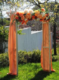 Beautiful for a fall wedding! #weddings #arch #pink #coral #ceremony #fabric #beverlys #beverlyfabrics