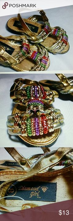 Diamond girl sandals girls size 8, Bling, gold Gold with purple and green bling. Buckle strap  Rubber Sole man-made materials.  Size 8 toddler girls.  New without tags or box diamond Shoes Sandals & Flip Flops