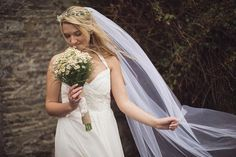 floral crown with small white flowers. short lace veil attached behind
