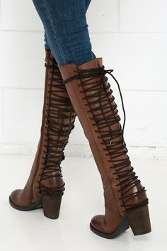 """The Steve Madden Rikter Cognac Leather Knee High Heel Boots are off the charts cute with a gorgeous genuine leather upper, and almond toe. Decorative dark brown laces weave up the back of a fitted, 17"""" shaft, that is perfect for slender calves. Zippered instep. Collar has a 14"""" interior circumference."""