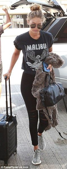 She was perhaps heading to cooler climes as she carried a snug-looking chunky-knit cardigan