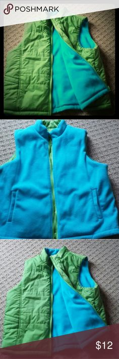 Women's Reversible Vest XL Fall & Winter Nylon lime green reverses to fleece warm toasty turquoise color. Fabric: 100% nylon outer vest, 100% polyester fleece & fiberfill. One tiny dot on green side, size of pencil mark, but not even enough for camera to pick up. Studio Works Jackets & Coats Vests