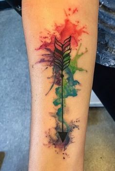 Watercolor Arrow Tattoo on Arm.