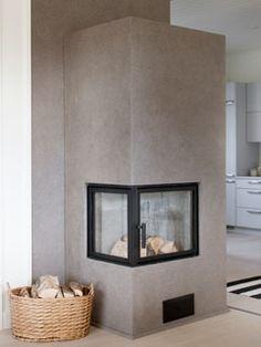 Tunto Kivi natural stone coating / Olohuoneen takka ja sen takaseinä on pinnoitettu Tikkurilan uudella Tunto Kivi -luonnonkivipinnoitteella.