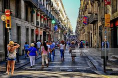 Lots of locals and tourists crowd the street 'carrer de ferran' in Barcelona.