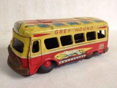 Vintage Daiya tin litho friction toy Grey Hound bus. Made in Japan.