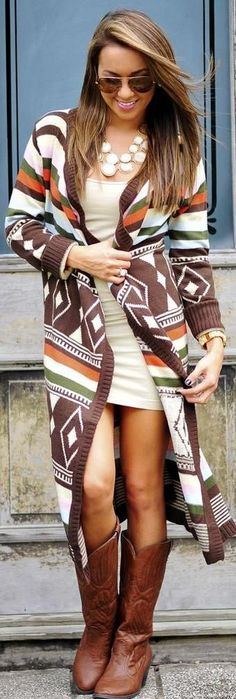 Love the cowboy boots with the oversized cardigan dress