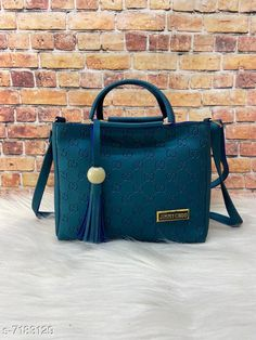 Handbags Women's Beautiful Sling Handbag Material: Leather No. of Compartments: 2 Pattern: Solid Multipack: 1 Sizes:Free Size (Length Size: 8 in Width Size: 3 in Height Size: 8 in)  Description-A beautiful sling bag with metal handle and diamond present in front one partition on top Country of Origin: India Sizes Available: Free Size   Catalog Rating: ★4 (474)  Catalog Name: Elegant Attractive Women Handbags CatalogID_1146299 C73-SC1073 Code: 113-7183129-846