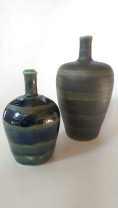 Small bottle neck vases I made out of porcelain. www.terrapursuits.com