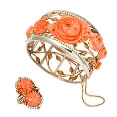 """1930s Carved Coral and Pearl Gold Bracelet and Ring. - 1930's Carved coral bracelet and ring set, by Detroit jeweler """"Wright Kay & Co."""" 14K white and yellow gold, with scrolling flowers and leaves, with 9 delicately carved coral peonies and Japanese chrysanthemums edged in pearls. Marked: Wright Kay & Co. 14K."""