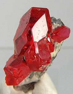 Realgar, monoclinic, very soft at 1.5 - 2 on Mohs scale. Disintegrates with long exposure to light to a powder compound containing arsenic. Toxic and carcinogenic.