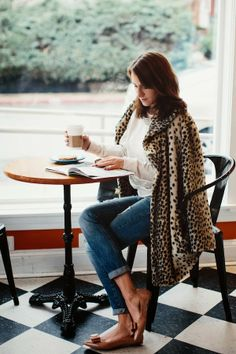 Leopard Coat + Comfy Sweatshirt + Distressed Denim + Bow Flats .... I WANT everything in this outfit!