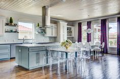 Acrylic ghost chairs are a clean addition to the island dining space.