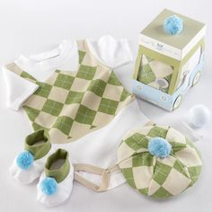 The bodysuit has matched with tam and white booties with green trim - both are with blue pom-pom accents. It is presented beautifully in a color-coordinated golf cart-inspired gift box with a clear window showcasing the layette. This layette set is made of 100% cotton and is machine-washable. The available size is for 0-6 months.